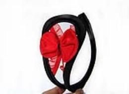 Neviditelná tanga Cstring elegance s červenou mašlí